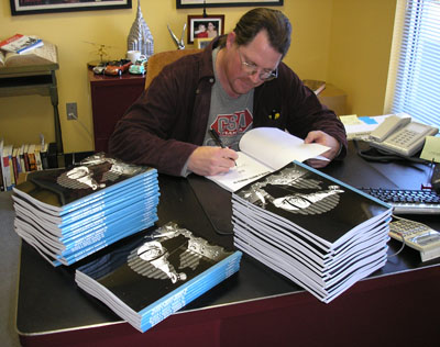 JohnSigningB4_400.jpg